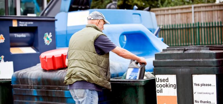 man recycling oil
